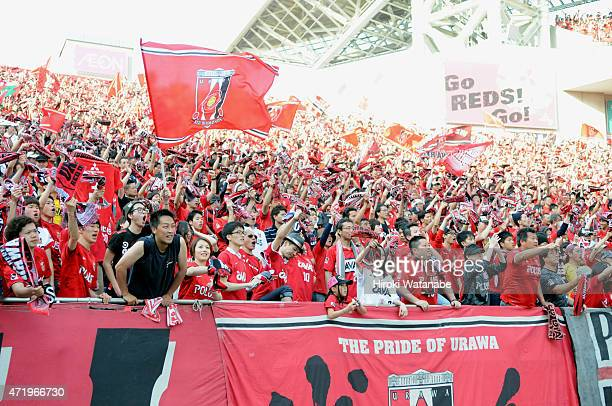 Urawa Reds supporters cheer during the JLeague match between Urawa Red Diamonds and Gamba Osaka at Saitama Stadium on May 2 2015 in Saitama Japan