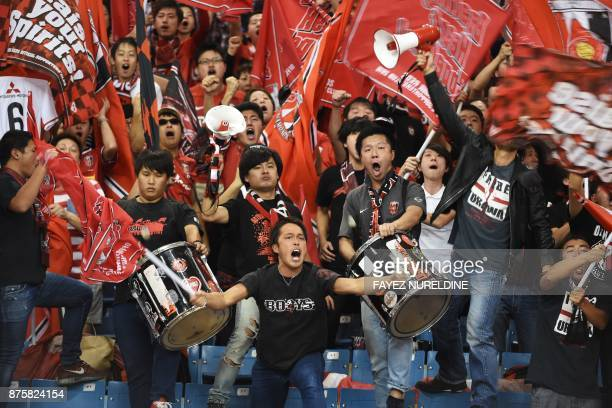 Urawa Reds' supporters cheer for their team during the Asian Champions League final football match between Japan's Urawa Reds and Saudi Arabia's...