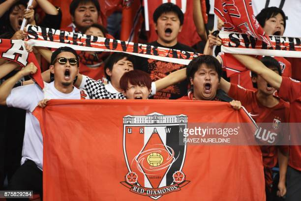 Urawa Reds' supporters cheer for their team during the Asian Champions League final football match between Saudi Arabia's AlHilal and Japan's Urawa...