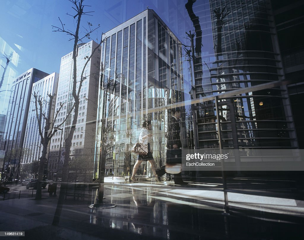 Urban abstract with office buildings and people : Stock Photo