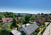 "High point view from Svendborgsund bridge in Svendborg. Urban area in Svendborg. Detached houses close to the sea ""Svendborgsund"""