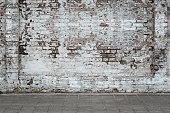 Urban background, white ruined industrial brick wall with copy space