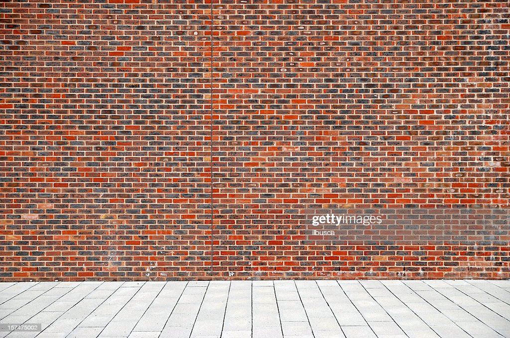 Urban background UK - Red brick wall with sidewalk