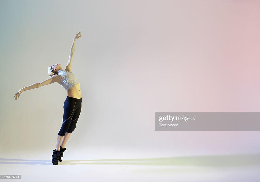 urban ballet dancer in graceful pose