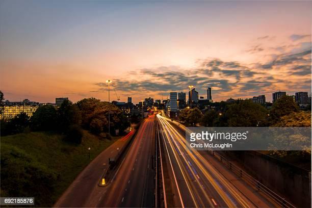 Urban city scene in Leeds, UK. Road into Leeds