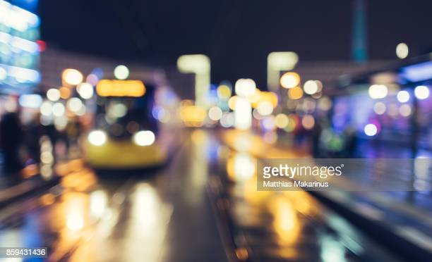 Urban City Street Szene with Bokeh Night Lights and defocused Train