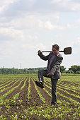 Urban farmer on a field of sugar beets in Zeeland, the Netherlands.