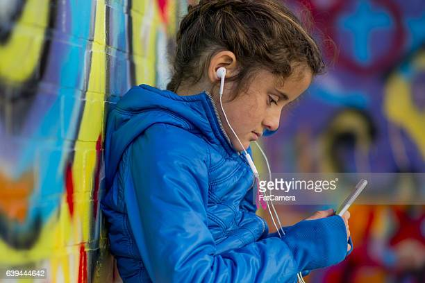 Urban Girl Using a Cell Phone