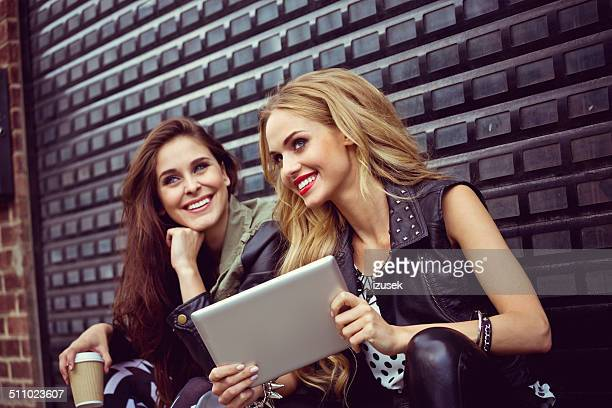 Urban Girls with digital tablet