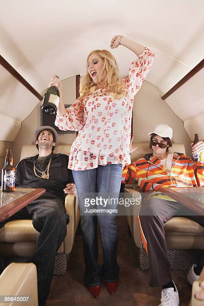 Urban hipsters on private airplane