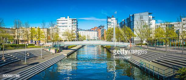 Urban housing apartment buildings beside tranquil city canal Helsinki Finland