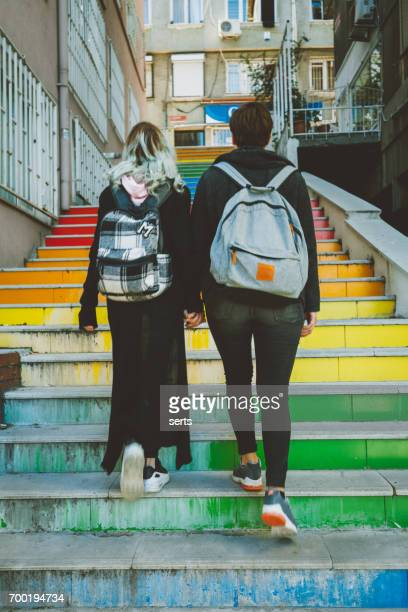 Urban lesbian couple walking on street