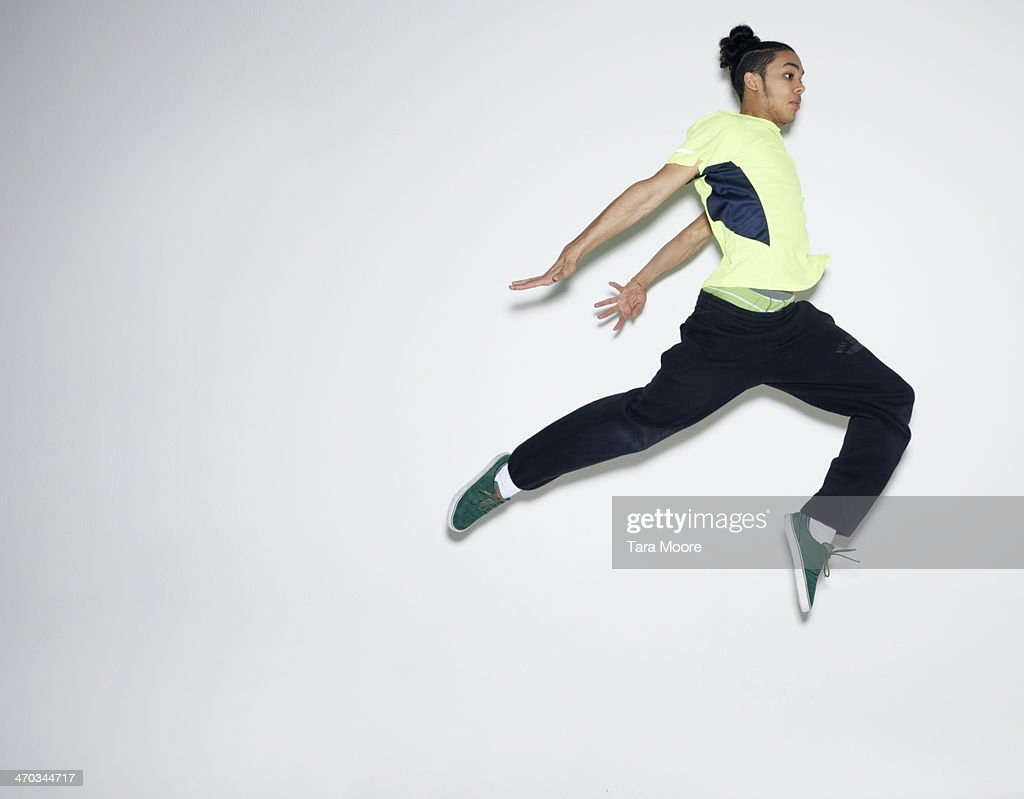 urban man jumping in air