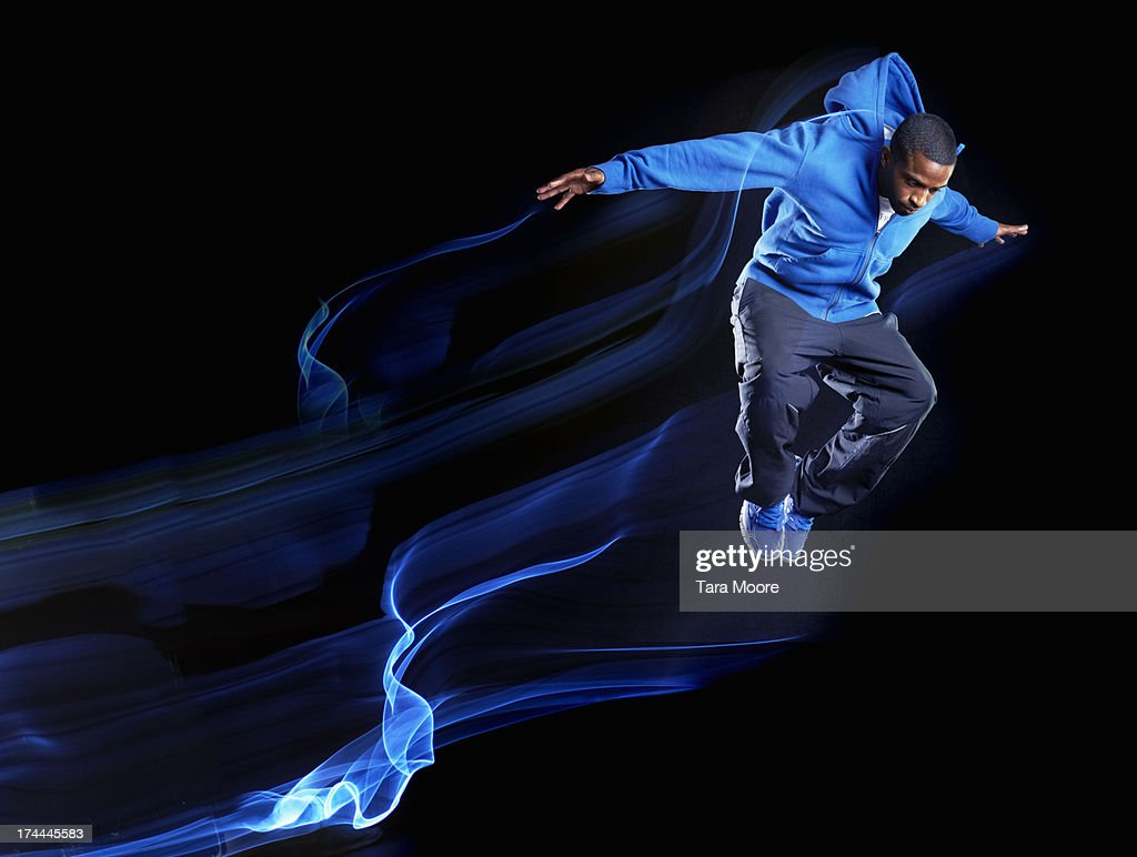 urban man jumping with light trails