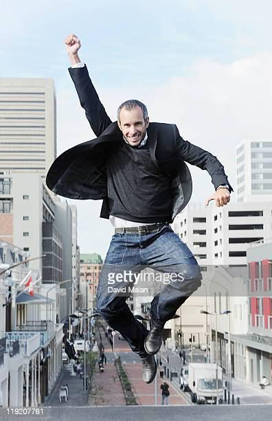 Urban man leaping with joy.