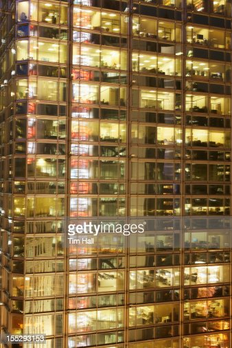 Urban office building lit up at night : Stock Photo