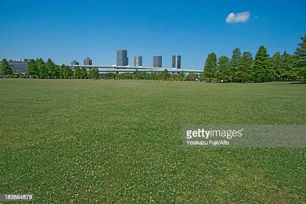 Urban park and blue sky with clouds
