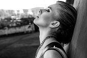 Urban portrait of beautiful girl. Black and white photo