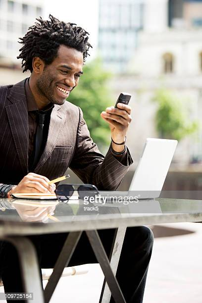 Urban professional taking a call while working out of office