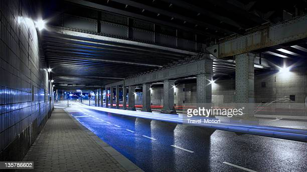 Urban road tunnel with light trails at night, Amsterdam