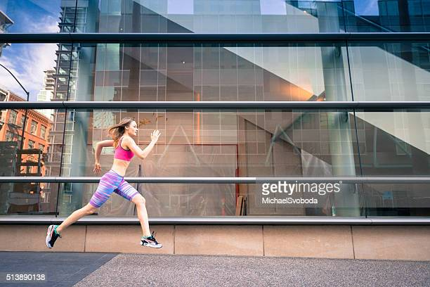 Urban Runner Against a Reflection in a Building