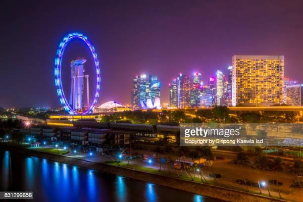 Urban skyline of Singapore at night.