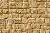 Urban Street Limestone Stone Wall From Rough Slab And Block Background Texture, Vintage Modern Facade, Horizontal Image With Copy Space, Close Up Front View,