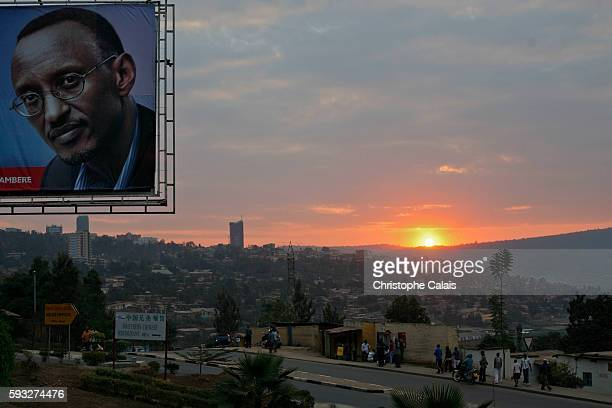 a view of the city at sunset with a campaign poster of President Paul Kagame for his reelection Urbanism development in Kigali a view of the center...