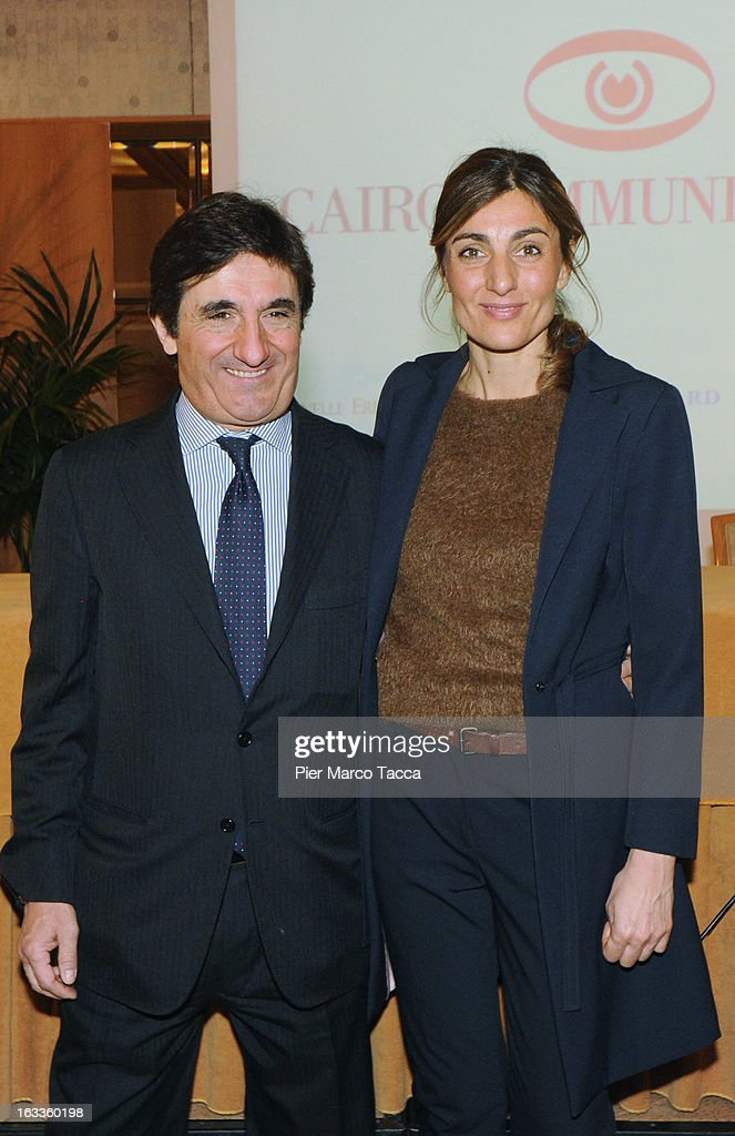 Urbano CairoMali Pelandini and his wife attend a press conference about acquiring La 7 television channel at Four Seasons Hotel on March 8, 2013 in Milan, Italy. Urbano Cairo, president of Cairo Comunication, has purchased the television channel La7 said at the press conference that none of the channel's 470 jobs were currently at risk and added that he would have a new business plan ready 'by June'.