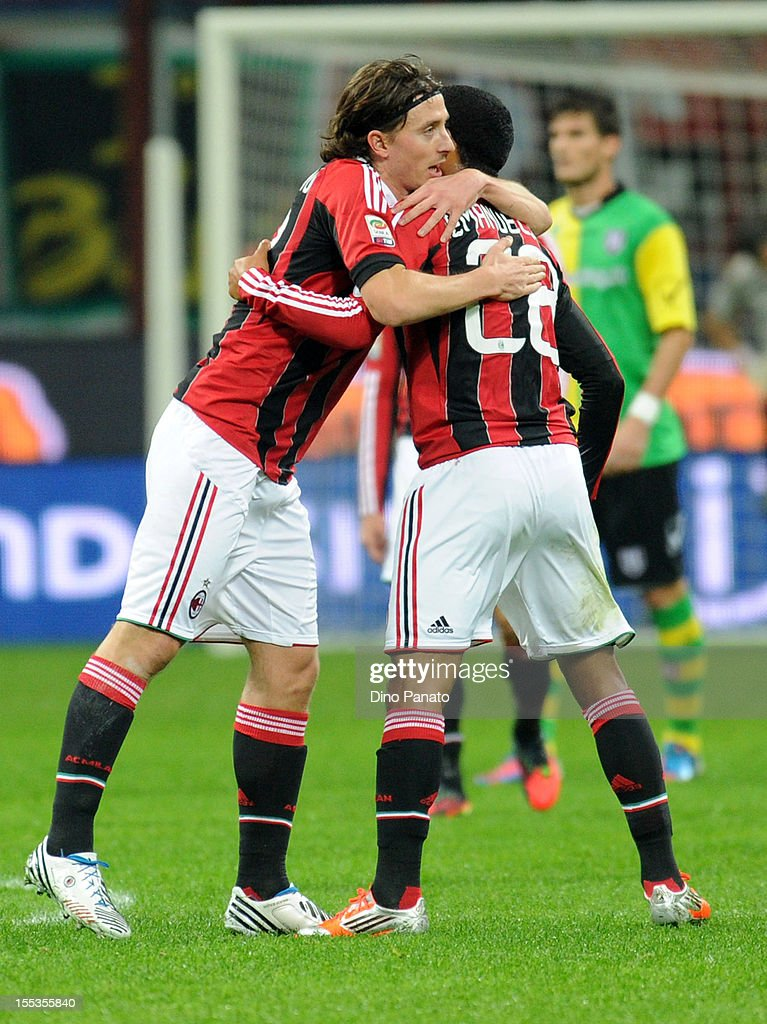 Urby Emanuelson (R) of AC Milan celebrates after scoring is opening goal with team mates Riccardo Montolivo during the Serie A match between AC Milan and AC Chievo Verona at San Siro Stadium on November 3, 2012 in Milan, Italy.