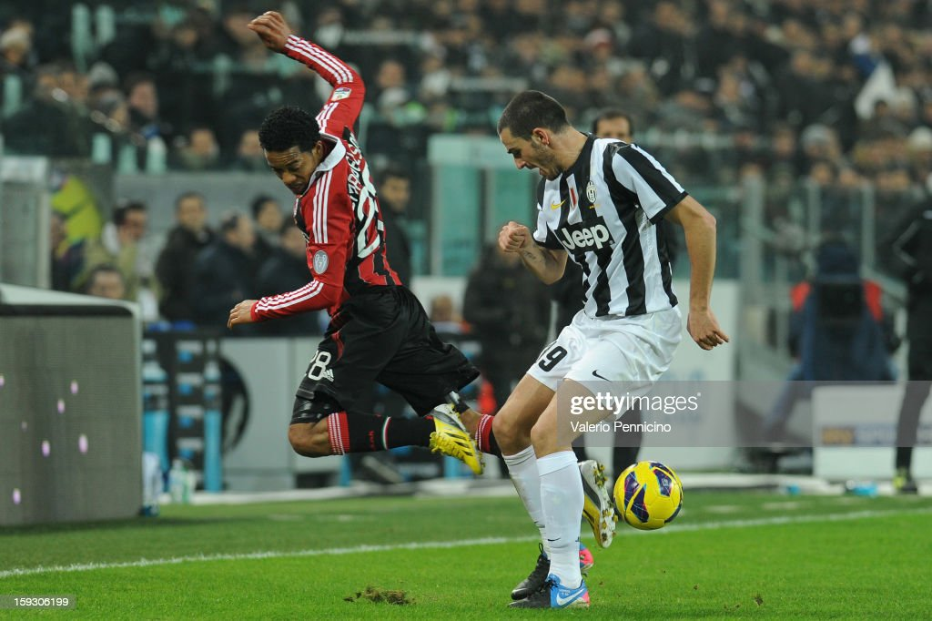 Urby Emanuelson of AC Milan is tackled by Leonardo Bonucci of Juventus FC during the TIM cup match between Juventus FC and AC Milan at Juventus Arena...