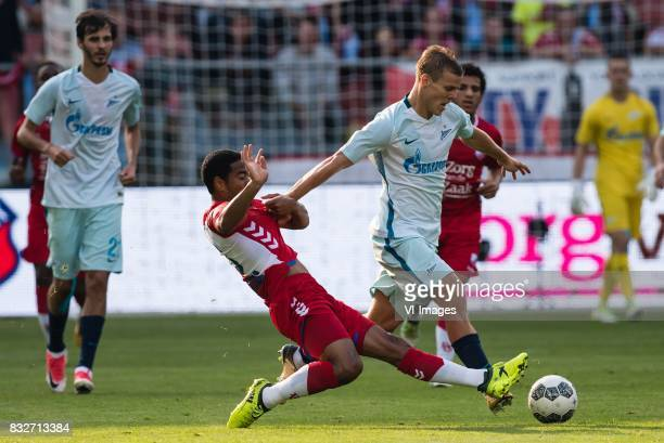 Urby Emanuelson of FC Utrecht Aleksandr Kokorin of FK Zenit St Petersburg during the UEFA Europa League fourth round qualifying first leg match...