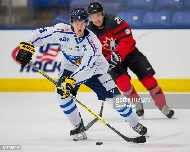 Urho Vaakanainen of Finland controls the puck against Canada during a World Jr Summer Showcase game at USA Hockey Arena on August 2 2017 in Plymouth...