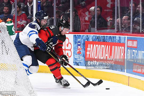 Urho Vaakanainen of Team Finland and Dillon Dube of Team Canada skate for the puck during the IIHF exhibition game at the Bell Centre on December 19...