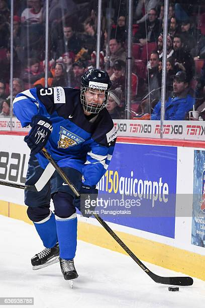 Urho Vaakanainen of Team Finland looks to play the puck during the IIHF World Junior Championship preliminary round game against Team Czech Republic...