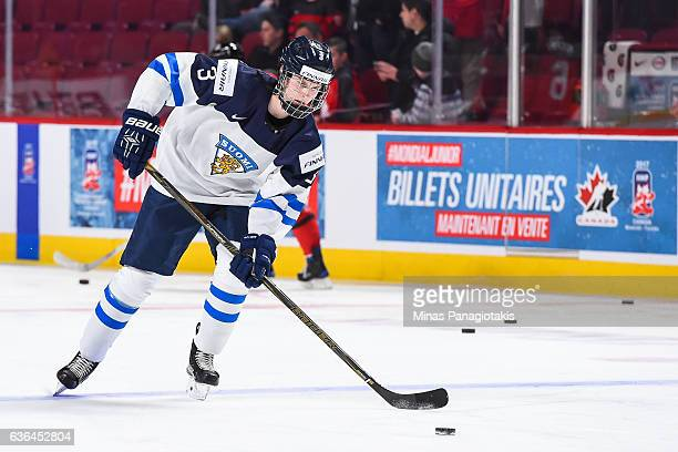 Urho Vaakanainen of Team Finland skates the puck during the warmup prior to the IIHF exhibition game against Team Canada at the Bell Centre on...