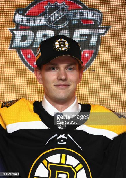 Urho Vaakanainen poses onstage after being selected 18th overall by the Boston Bruins during Round One of the 2017 NHL Draft at United Center on June...