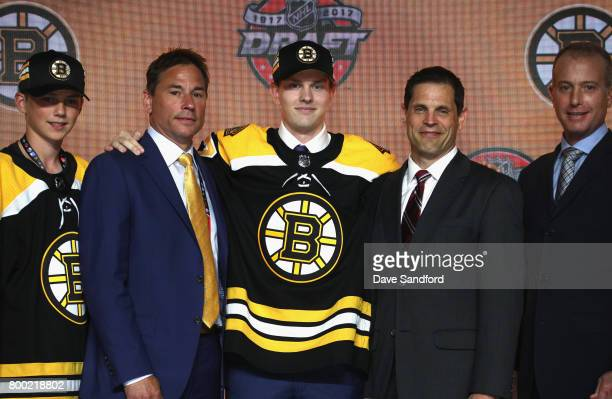 Urho Vaakanainen poses onstage with general manager Don Sweeney after being selected 18th overall by the Boston Bruins during Round One of the 2017...