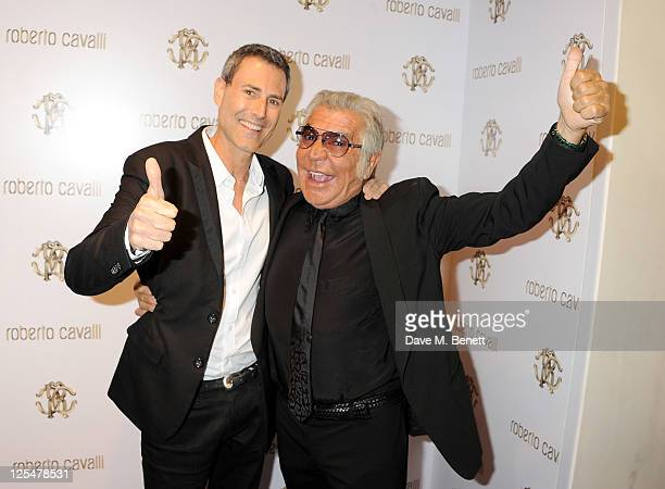 Uri Geller and Roberto Cavalli attend the opening of Roberto Cavalli's new Sloane Street boutique on September 17 2011 in London England