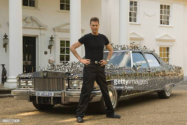 Uri Geller at home in Berkshire England with his custom built 1976 Cadillac encrusted with over 5000 pieces of contorted and bend spoons and cutlery