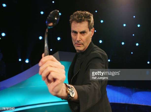 Uri Geller deforms a spoon during a photocall for his new show 'The next Uri Geller Unglaubliche Phnomene Live' on January 6 2008 in Cologne