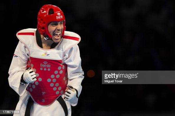 Uriel Adriano of Mexico celebrates after winning against Raul Martinez of Spain during a men's 74kg combat as part of WTF World Taekwondo...
