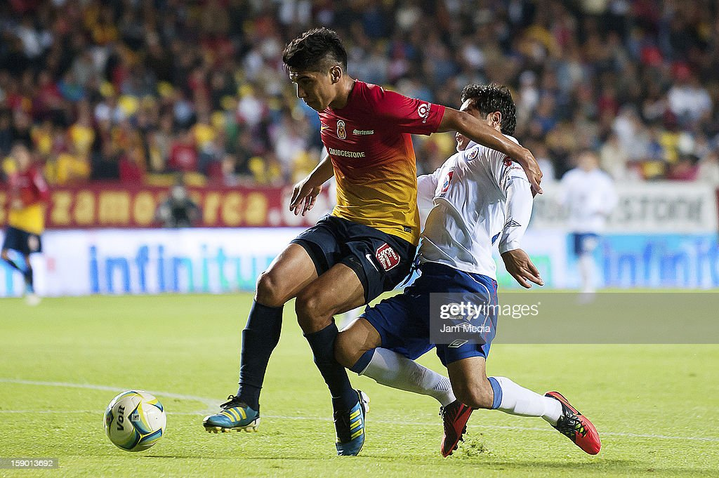 Uriel Alvarez (L) of Morelia struggles for the ball with <a gi-track='captionPersonalityLinkClicked' href=/galleries/search?phrase=Javier+Orozco&family=editorial&specificpeople=5505680 ng-click='$event.stopPropagation()'>Javier Orozco</a> (R) of Cruz Azul during a match as part of the Clausura 2013 Liga MX at Morelos Stadium on january 04, 2013 in Morelia, Mexico.