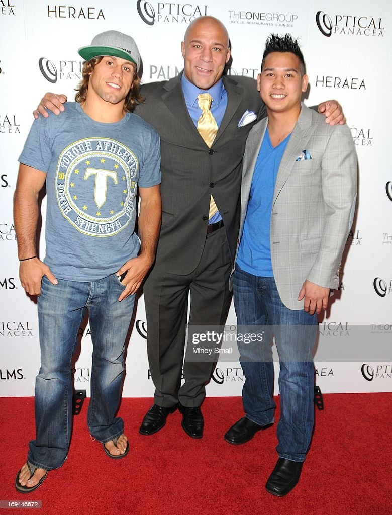 <a gi-track='captionPersonalityLinkClicked' href=/galleries/search?phrase=Urijah+Faber&family=editorial&specificpeople=2312319 ng-click='$event.stopPropagation()'>Urijah Faber</a>, Frank Trigg and Sam Hon attend the Optical Panacea Launch Party at HERAEA at the Palms Casino Resort on May 24, 2013 in Las Vegas, Nevada.