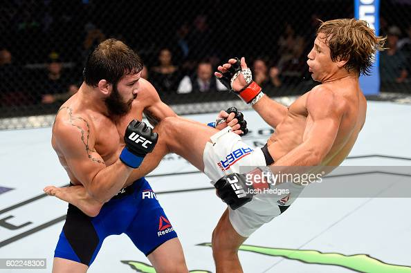 Urijah Faber kicks the torso of Jimmie Rivera in their bantamweight bout during the UFC 203 event at Quicken Loans Arena on September 10 2016 in...