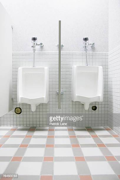 Bathroom Urinal two men urinal stock photos and pictures | getty images