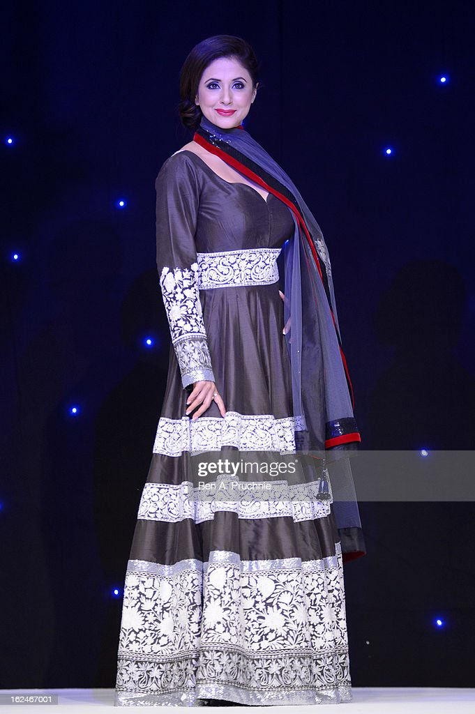 <a gi-track='captionPersonalityLinkClicked' href=/galleries/search?phrase=Urmila+Matondkar&family=editorial&specificpeople=2123211 ng-click='$event.stopPropagation()'>Urmila Matondkar</a> walks in a catwalk show during a charity fundraising event hosted by Manish Malhotra in aid of 'Save the Girl Child' at The Grosvenor House Hotel on February 23, 2013 in London, England.