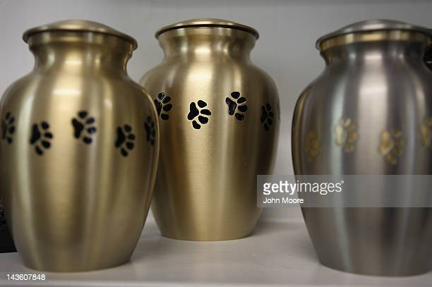 Urns designed for pets' ashes are displayed for sale at the Hartsdale Pet Cemetery and Crematory on April 30 2012 in Hartsdale New York The cemetery...