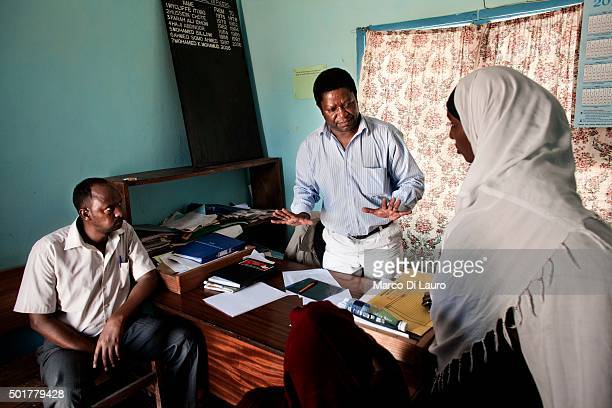 urologist John Wachira 54yearsold is seen with patients at the Wajir Government Hospital on February 15 2011 in Wajir Kenya Dr Wachira is expected by...