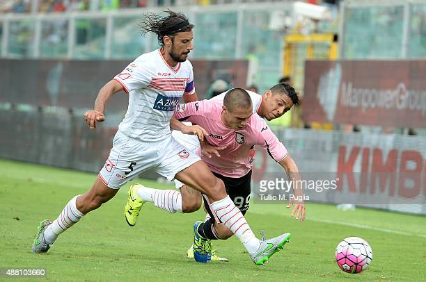 Uros Djurdjevic of Palermo is challenged by Cristian Zaccardo of Carpi during the Serie A match between US Citta di Palermo and Carpi FC at Stadio...